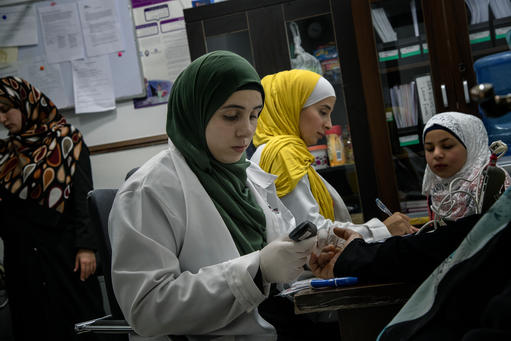 Nurses Feda' Abu Rashed (Left) and Ala' Al-Share' (Right)