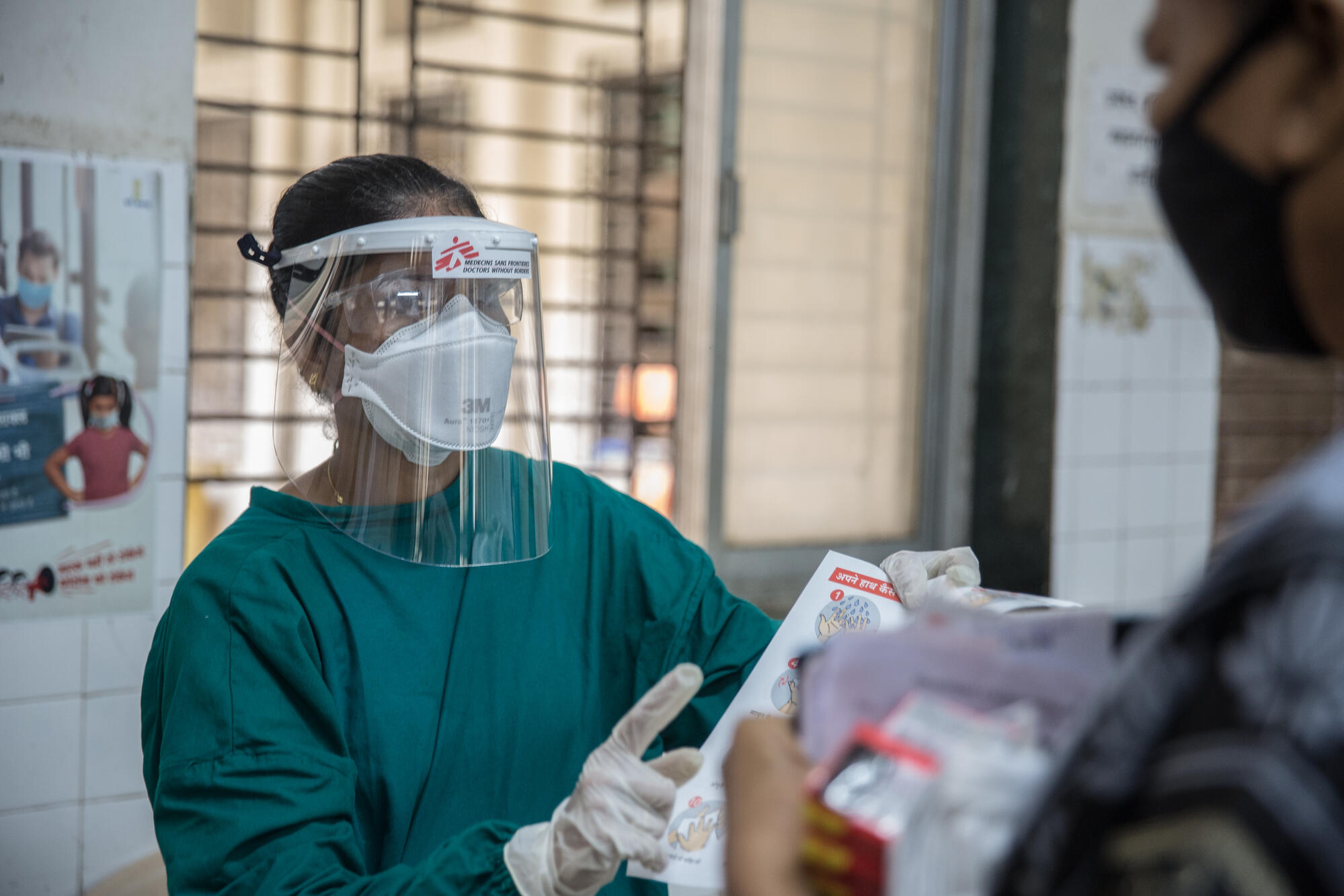 MSF nurse giving instrctions for safety.jpg