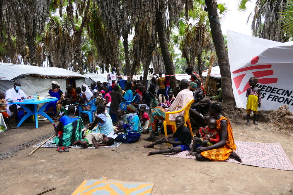Displacedpeople living in Roupgak wait for a medical consultation with an MSF mobile team
