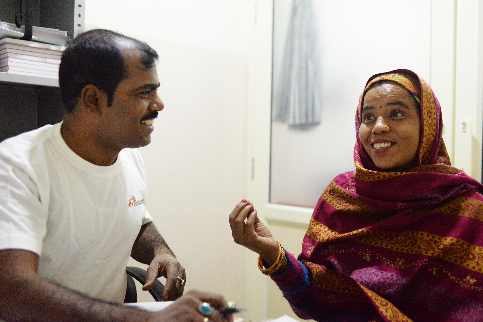Geeta, a hepatitis C patient at the MSF project in Meerut, reacts as she's informed that she was now cured of the disease