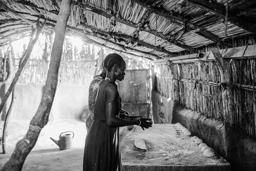 Women baking bread in a women's hostel in Bentiu town