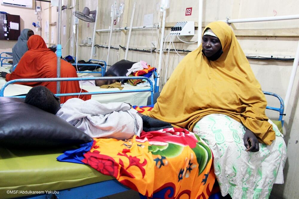 Grandmother takes care of an orphan in Gwange hospital