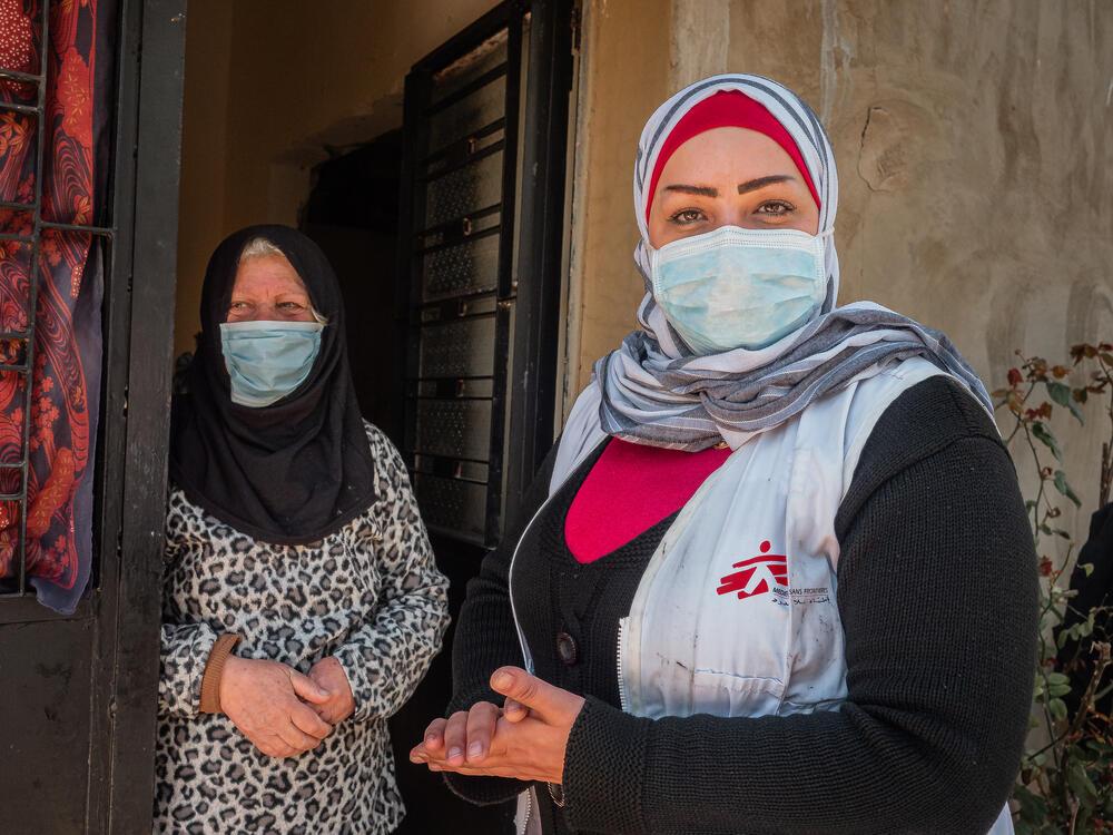 Fawziyya Al-Sahili with social worker