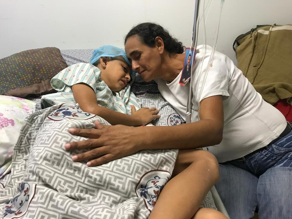 Roiber's mother embraces him in the hospital