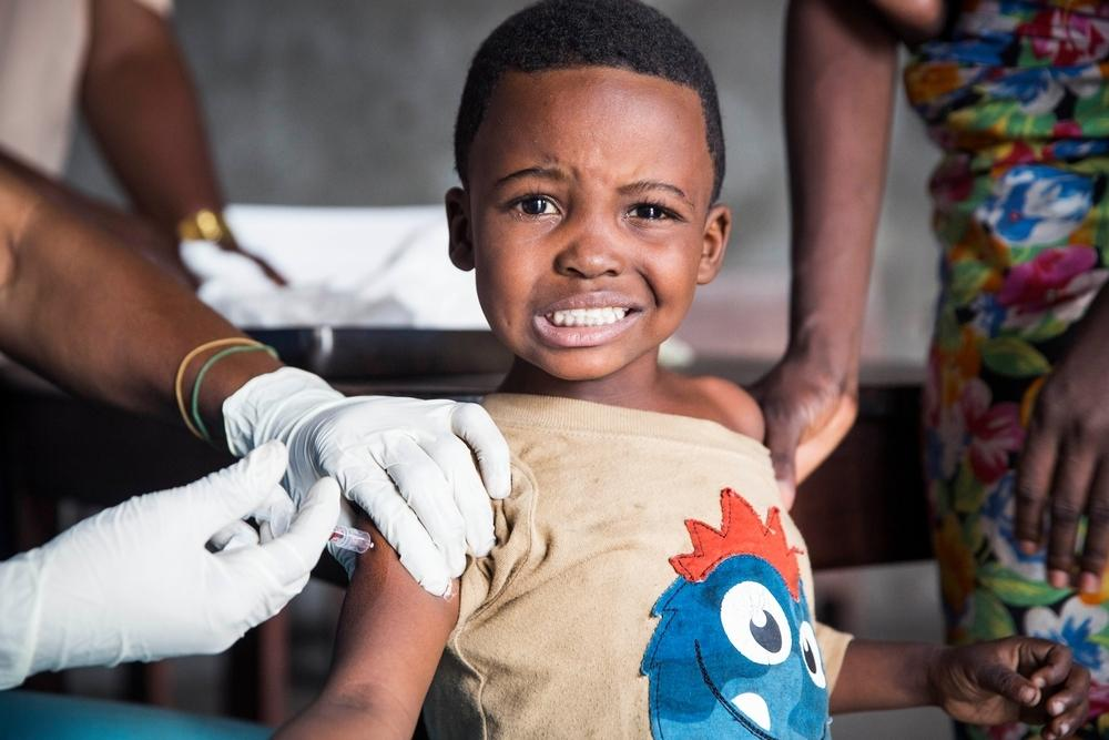 A boy receives a vaccination for Yellow Fever in Kinshasa, DRC