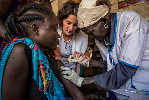 South Sudan: Midwife Camille shows a traditional birth attendant how to vaccinate a pregnant patient.