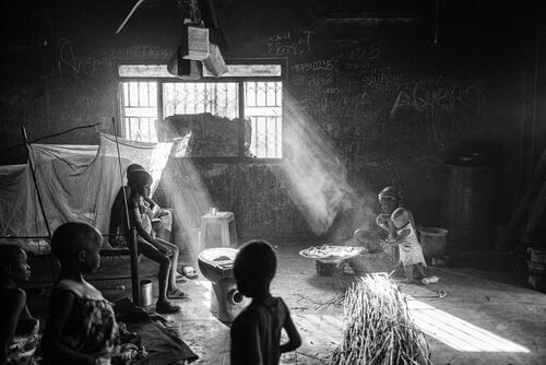 A family living inside an abandoned house on the outskirts of the town