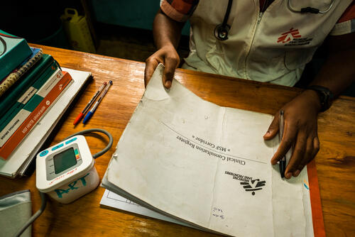 MSF clinical officer James Mponya looks through the register while working in MSF's one-stop-clinic, Dedza district hospital in