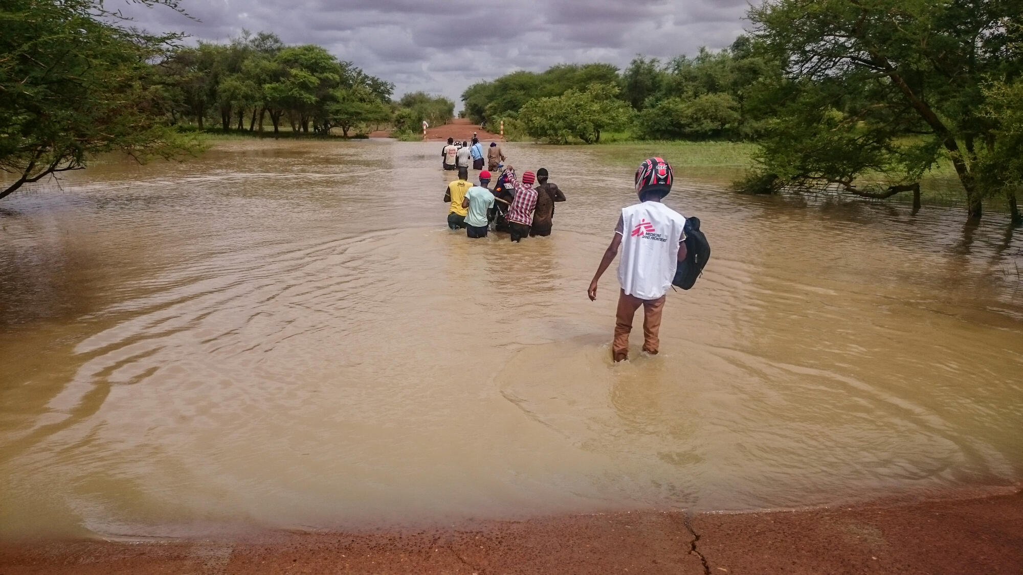 MSF staff crossing the river