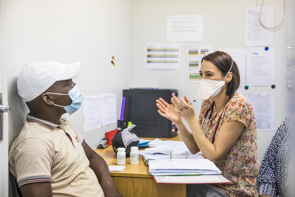 Dr Louisa Dunn, an investigator on the TB PRACTECAL clinical trial, consults with a patient.