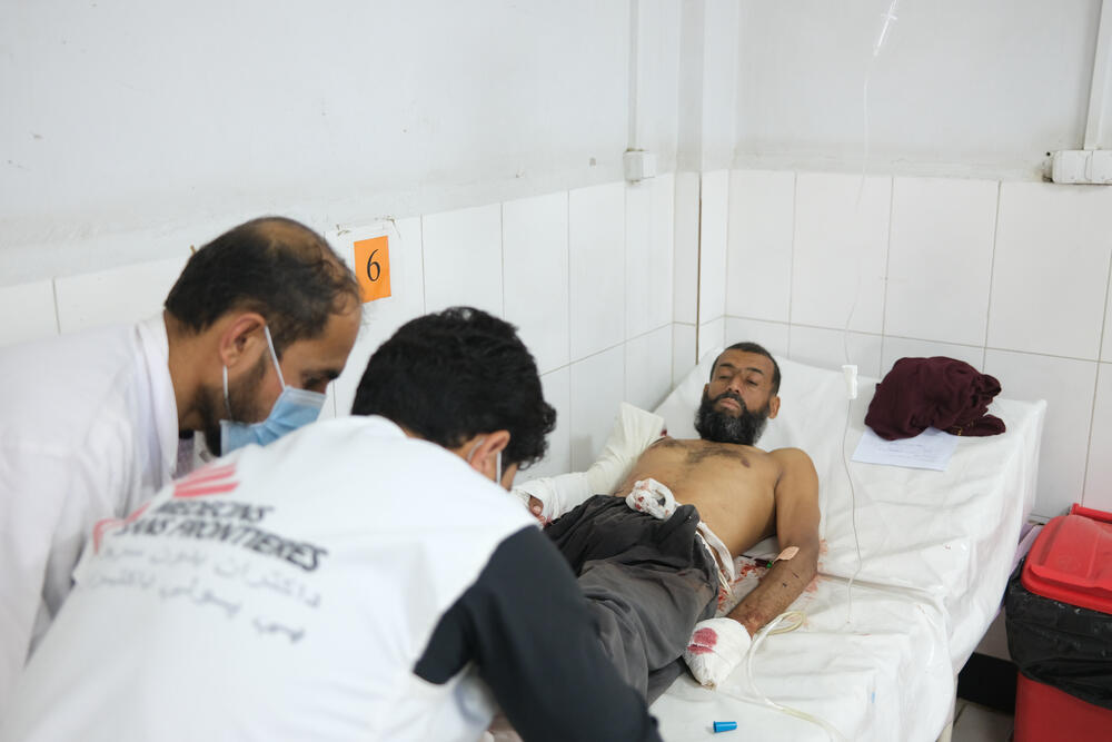 A patient being treated for gunshot injuries at Boost Hospital