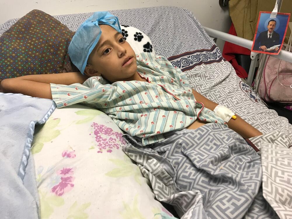 11 year old Roiber lies in his hospital bed in Caracas, Venezuela