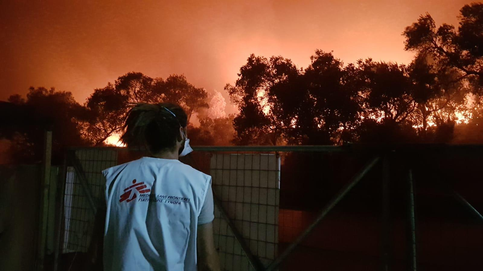 A member of the MSF team watches the fires at Moria Camp in Greece