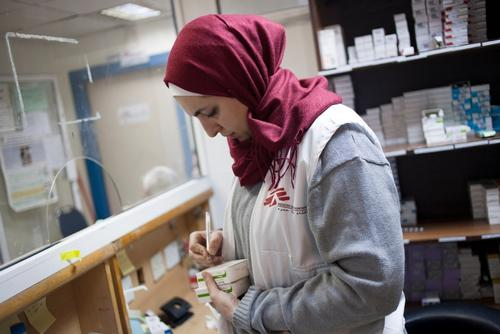 MSF Pharmacist Nour S. Barakat in the pharmacy where patients collect their medications after their medical consultation.
