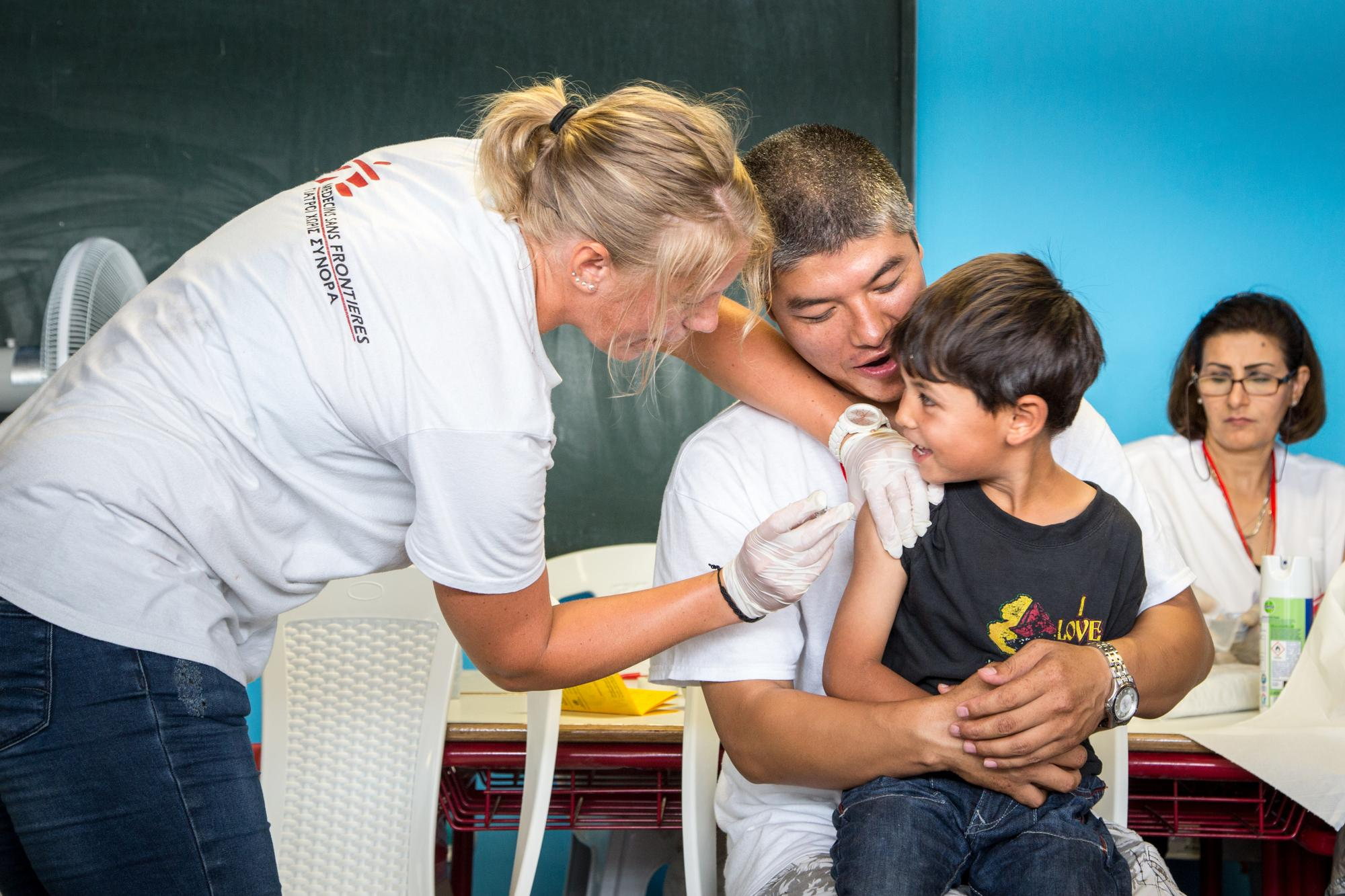 A young boy receiving vaccine
