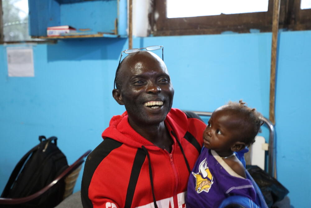 Jacques Zumbo and his daughter Tsimba, who is recovering from typhoid fever after being treated by MSF emergency teams