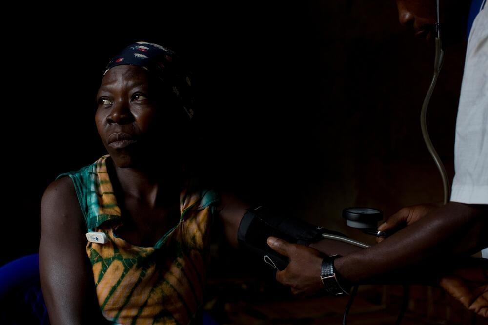 An MSF nurse examines a sleeping sickness patient in Doromo, DRC.