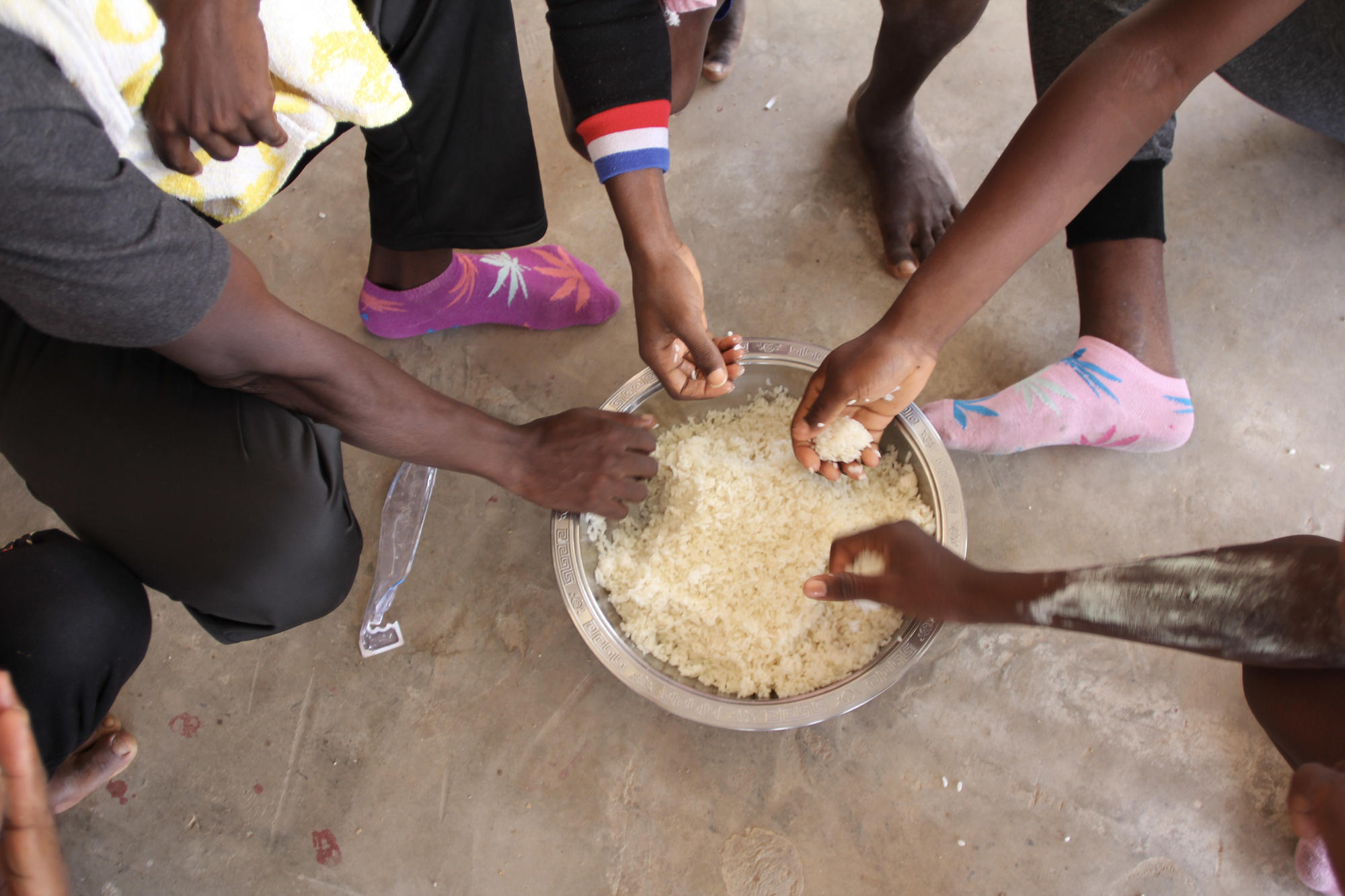 Refugees and migrants detained in the detention centre get rice or pasta for lunch and dinner.