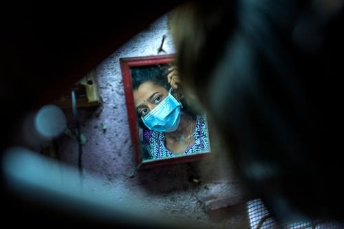 XDR-TB patient Nischaya, at home in the Ambedkar Nagar area of Mumbai.