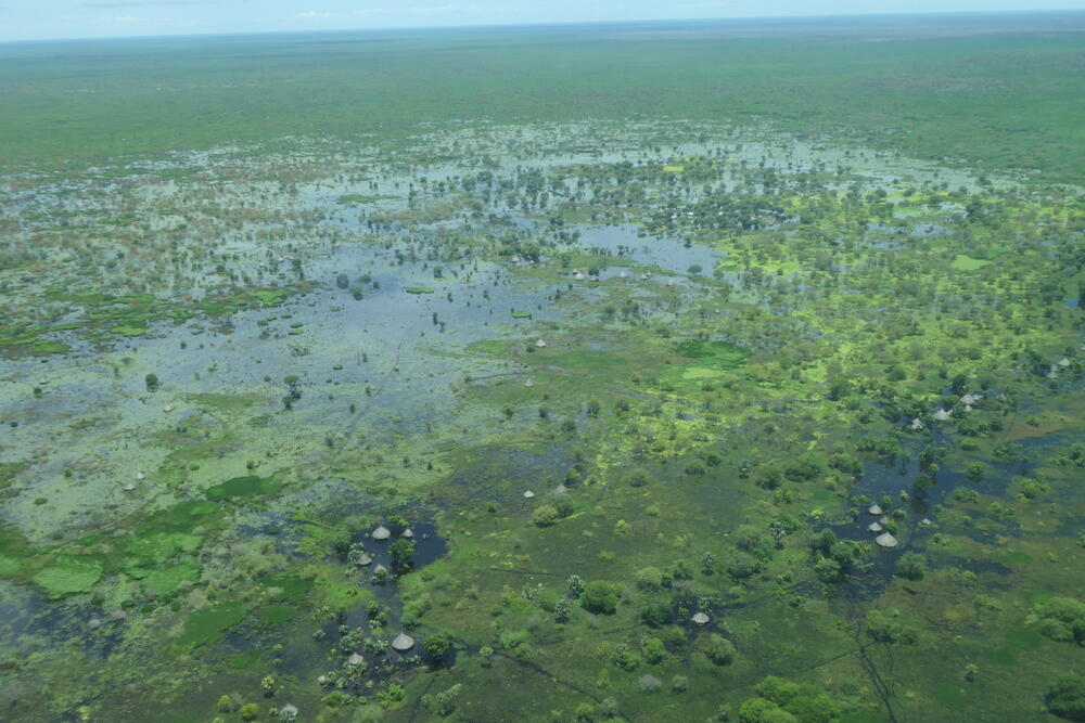Aerial view of a vast flooded area in Fangak County – local houses can be seen surrounded by water