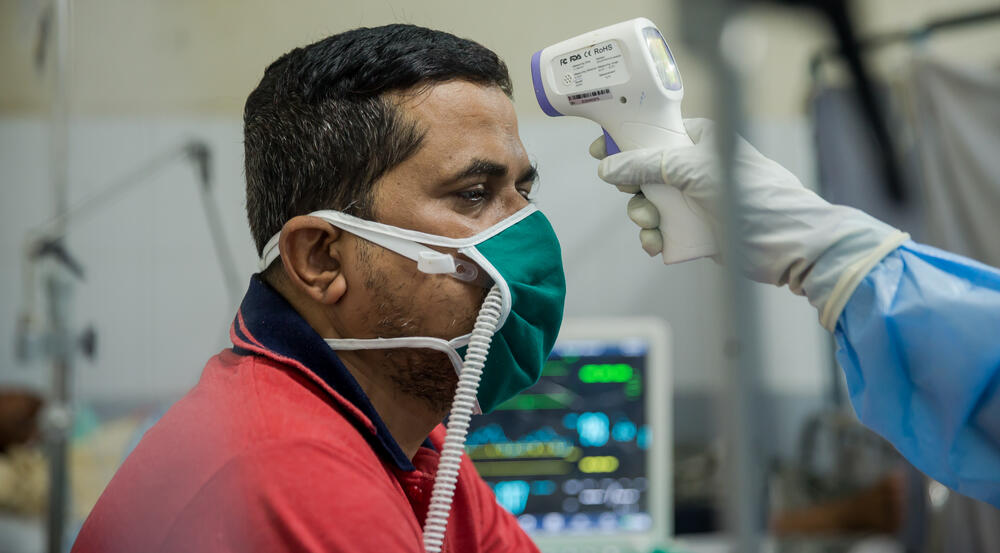 Patient Pramod getting his temperature checked at the HFNC.jpg