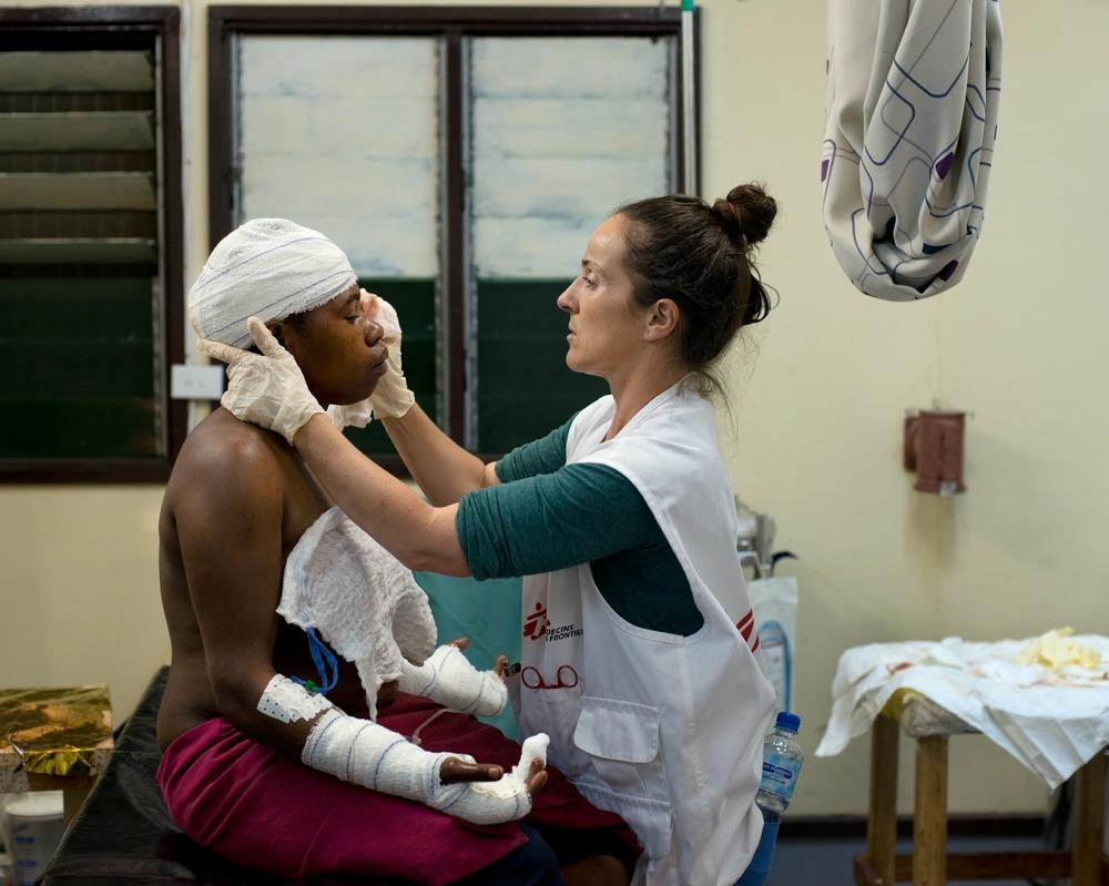 A woman in Hela Province, Papua New Guinea, is treated after her husband attacked her with a knife.