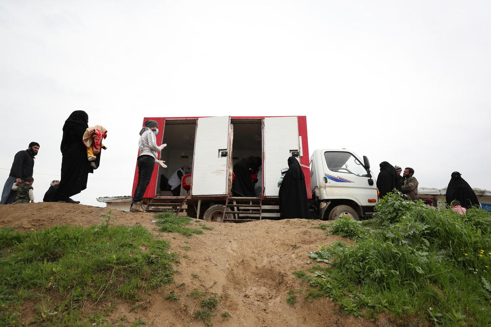 Social distancing outside MSF's mobile clinic in northwest Syria