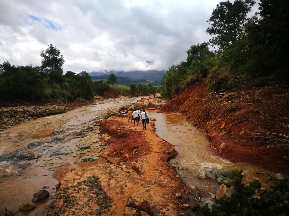 An MSF team travel by foot to access a village cut off by Cylone Idai in Chimanimani, Zimbabwe