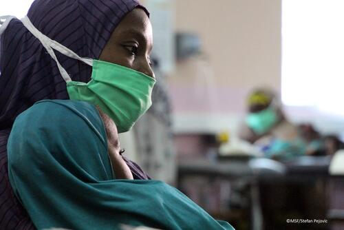 Mother and a child waiting for admission in Gwange hospital