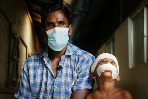 Rohingya refugee Abu and his son – Cox's Bazar, Bangladesh, 6 August 2020