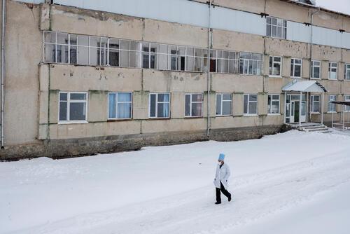 A doctor walks beside a hospital – Kadamjay, Kyrgyzstan, 18 February 2020