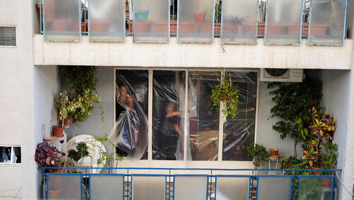 Beirut residents cover their windows with plastic sheets – Beirut, Lebanon, 5 August 2020