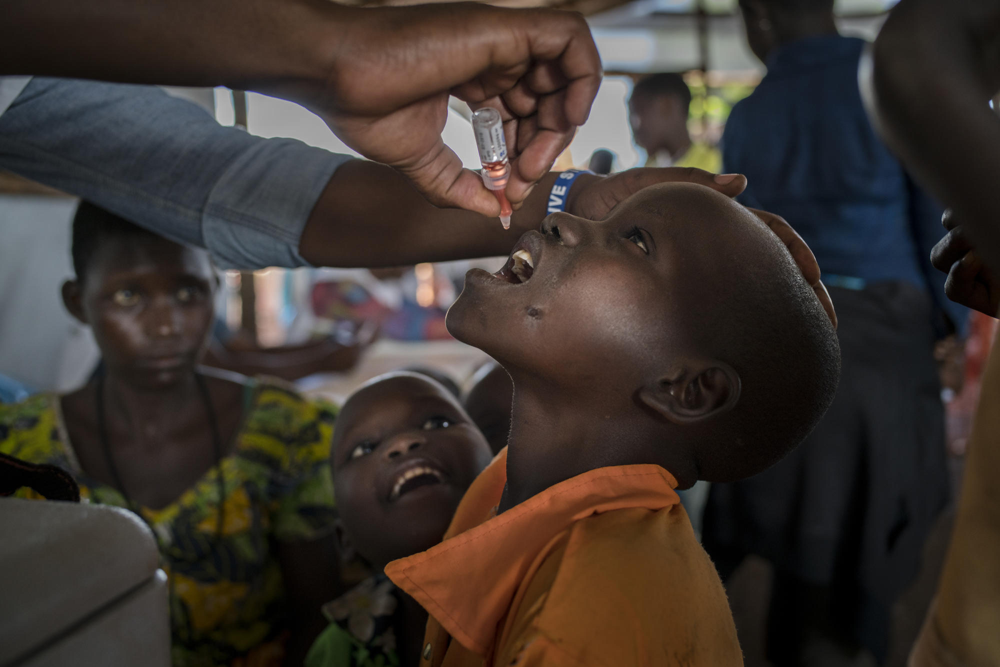 A Congolese refugee child receives a polio vaccine at the reception center in Kyangwali, Uganda.