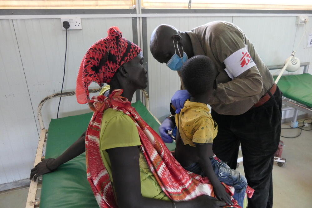 At the MSF hospital in Bentiu camp, a medic checks on a four-year-old boy who has tested positive for hepatitis E