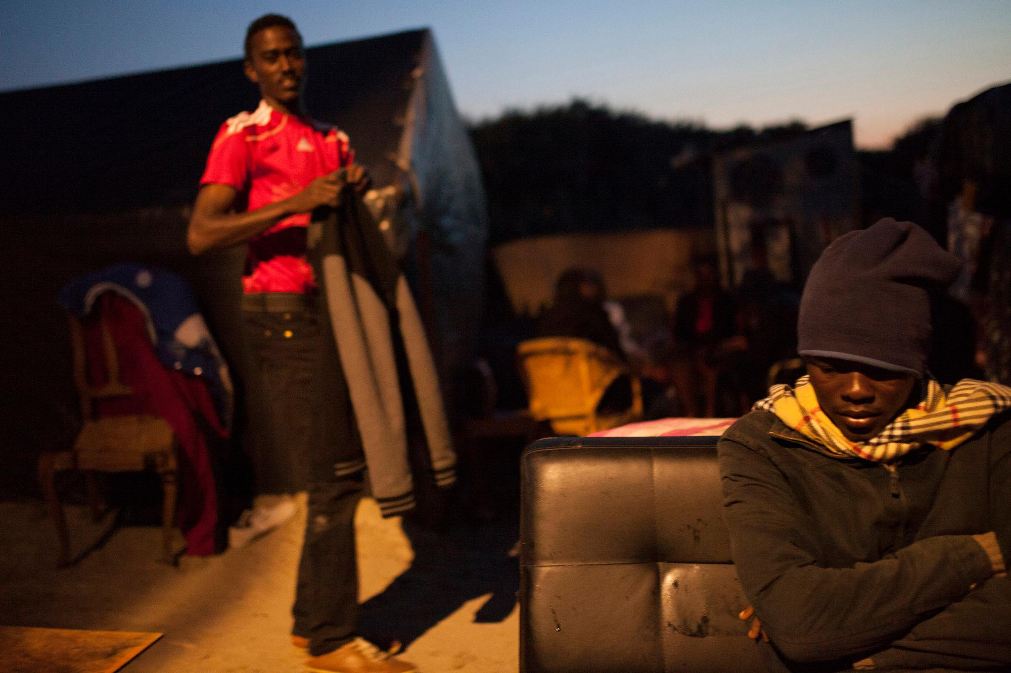 """Refugees in the """"jungle"""", a site in Calais, France."""
