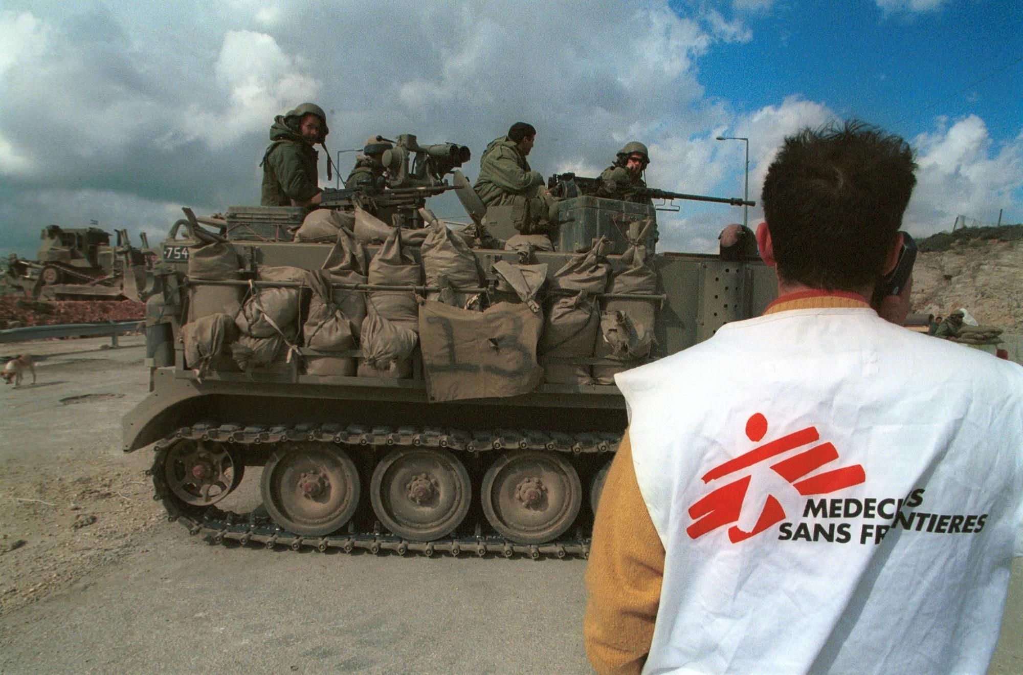 An MSF staff member waits at a check point in Palestine.