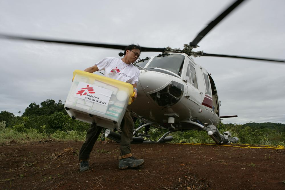 MSF staff unload medical supplies from a helicopter in the northern Sumatra province of Indonesia.