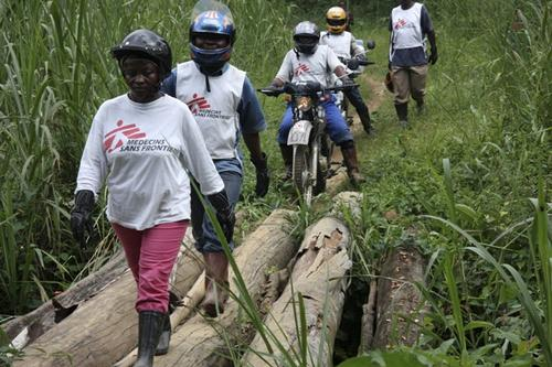 Mobile clinic by motorbike around Pinga in North Kivu province Democratic Republic of Congo 2012