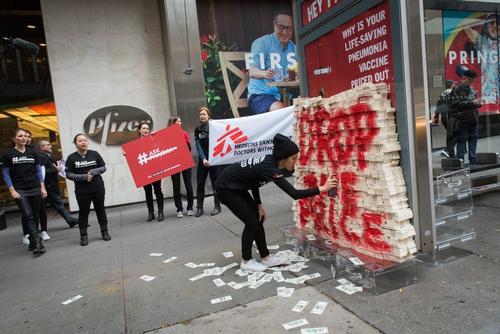 MSF staff and supporters protest the high price of the pneumonia vaccine outside Pfizer global headquarters in New York