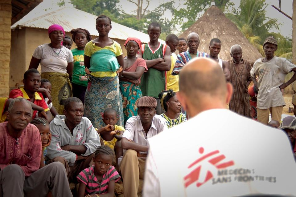Epidemiologist Michel Van Herp explains to the population in Gbando what is Ebola and how to avoid transmission.