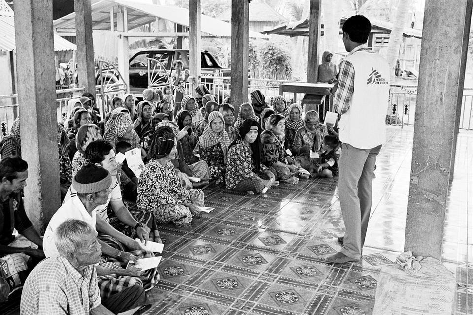 Khen Rith conducts TB health education in Angkor Chea village, Cambodia.