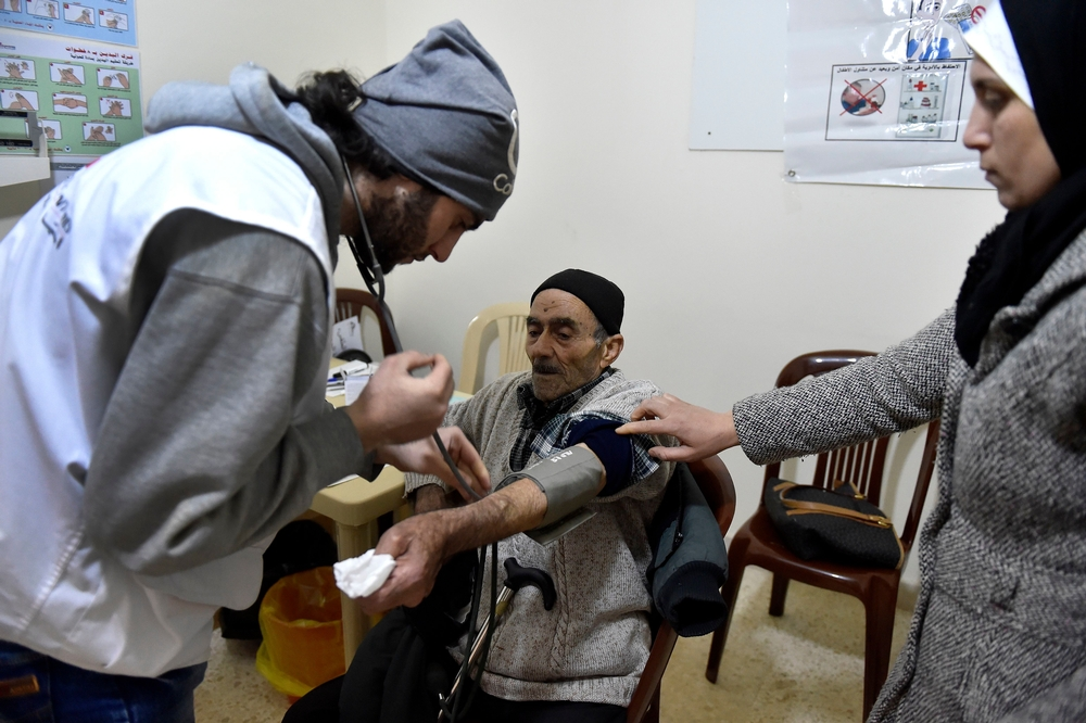 MSF medical staff take a patient's vital signs. Photo by Abbass Salman/MSF