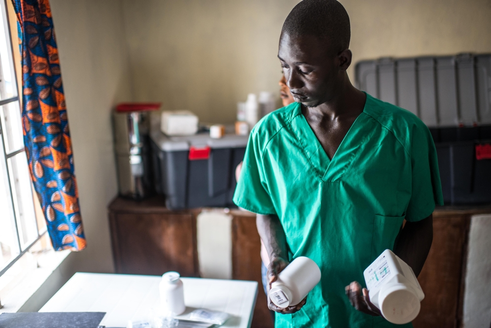 Nurse Alex Mambu prepares drugs for the day in the MSF Ebola survivor clinic in Magburaka, Sierra Leone.