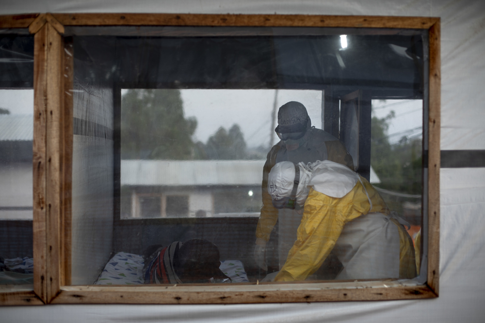 Medical staff in full PPE do the medical shift to check the state of the suspected cases of Ebola.