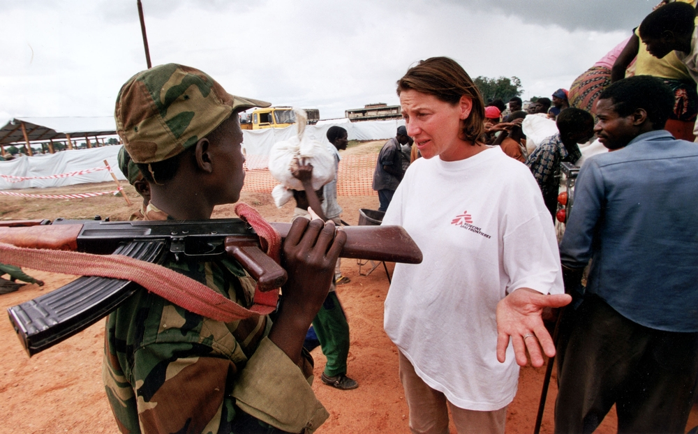 A Doctors Without Borders Staff Member Has Discussion With An Armed Soldier