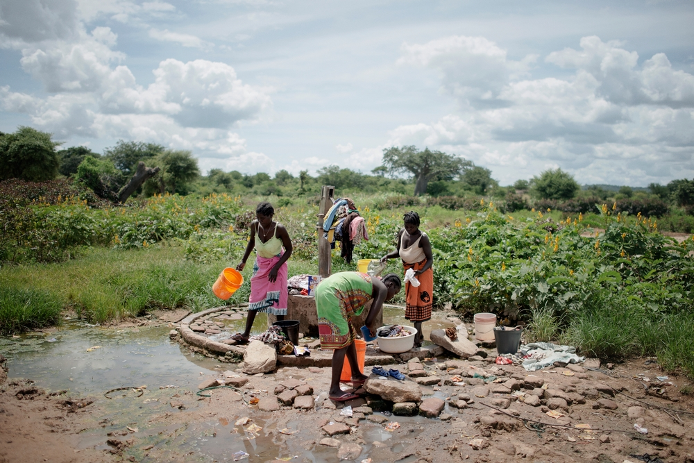 Mozambican women wash clouds using one of the public water pomps in Dégué village, Chiringa area, approximately 30km (18 miles) from Tete city. Photo: Luca Sola