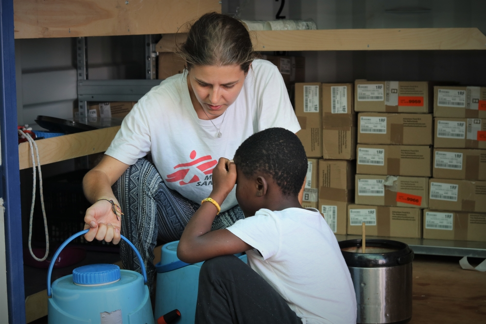 MSF Medical Team Leader, Stefanie, with a rescued child on board the Ocean Viking.   Over a week since Ocean Viking's first rescue, there are 356 people on board. MSF are still expecting to be assigned a place of safety for the disembarkation.