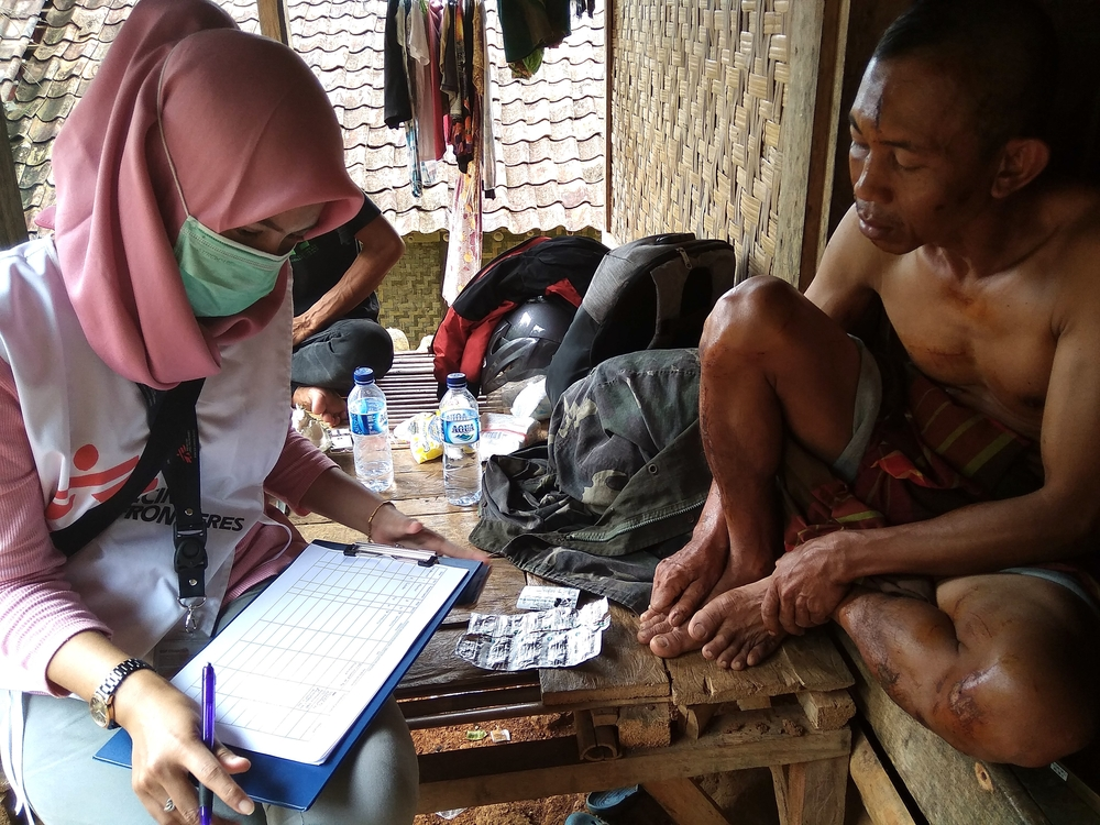 An MSF midwife, is interviewing one of the community members