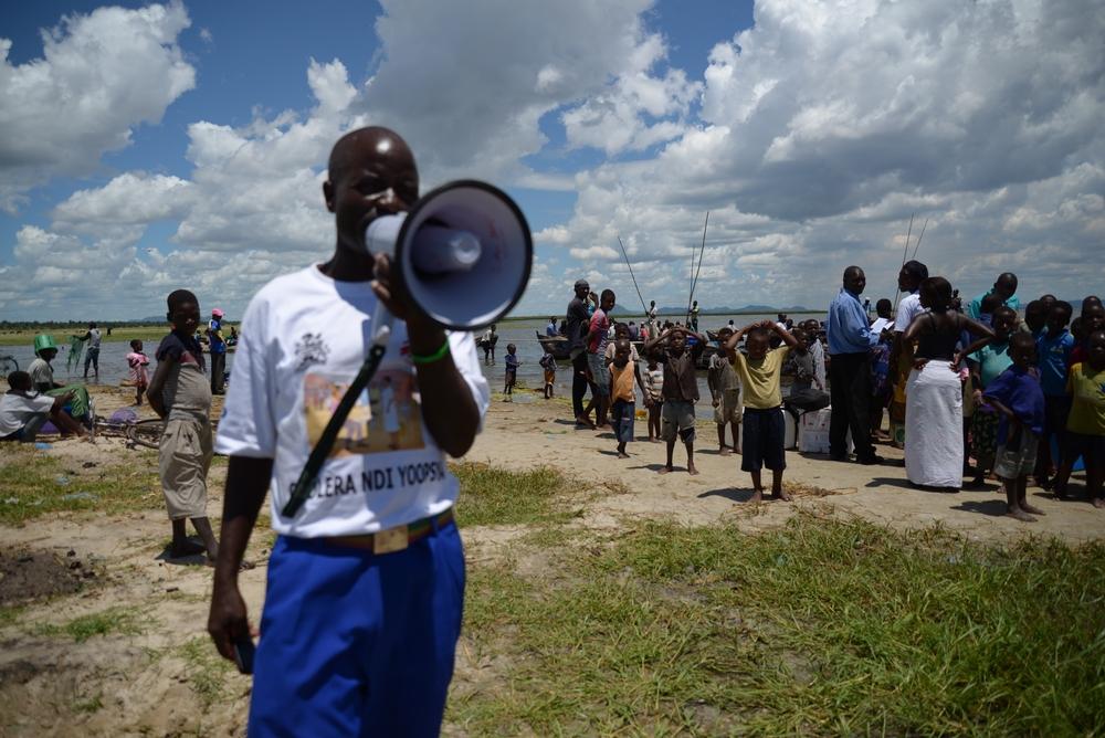 A man announces a message on megaphone