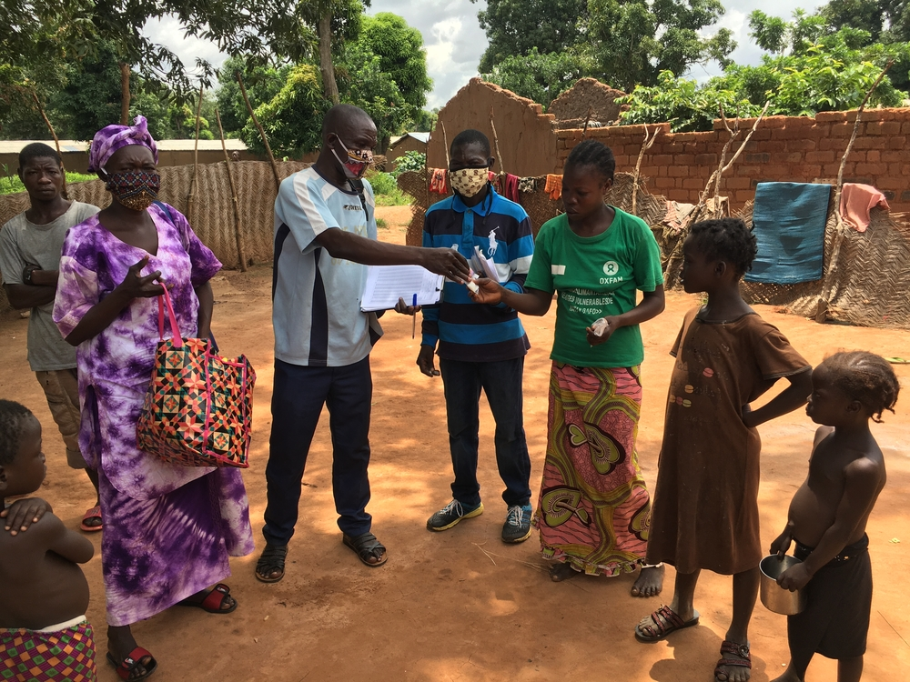 An MSF team handing out preventative treatment for malaria to the residents of Bataganfo, CAR